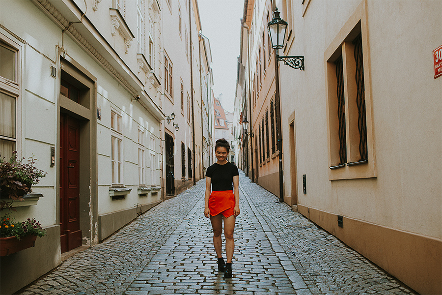 Girl wearing a red skort in the streets of Prague