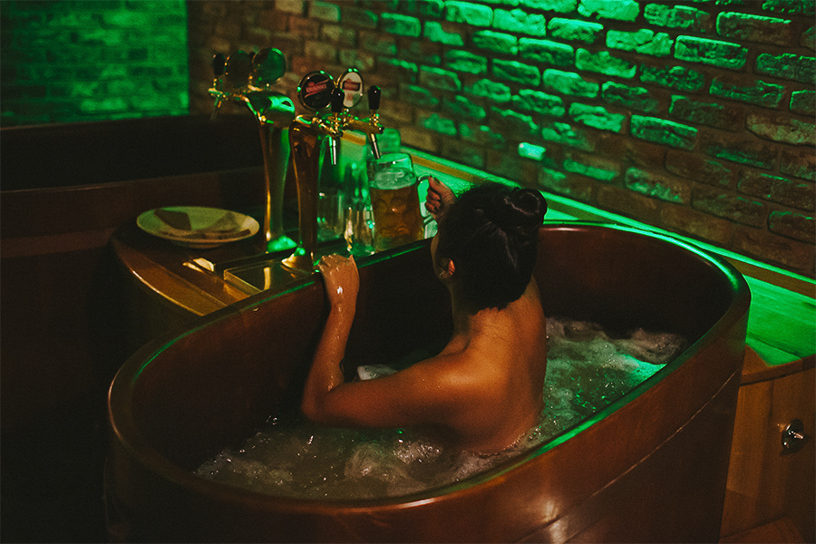 Girl taking a beer bath