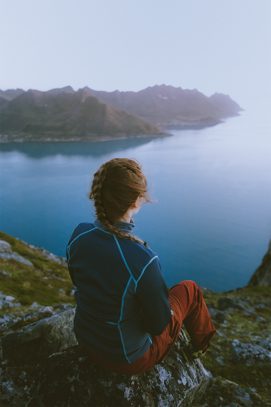Girl with braided hair looking at Senja