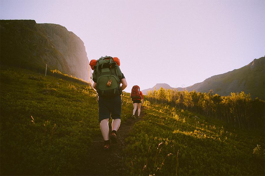 Two people hiking in Senja