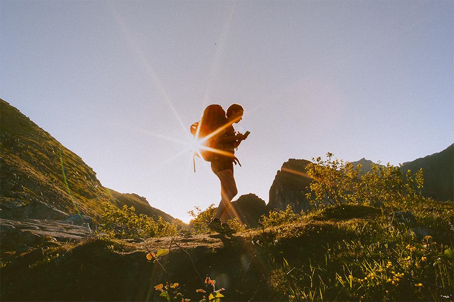 Girl hiking in midnight sun