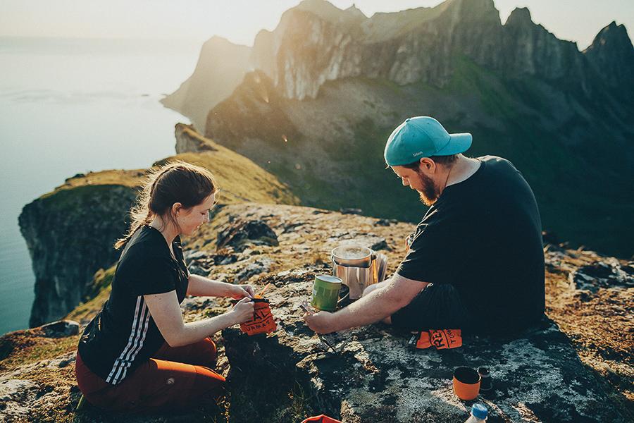 Two campers making food in Senja