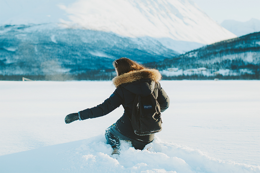 Girl trying to walk in deep snow