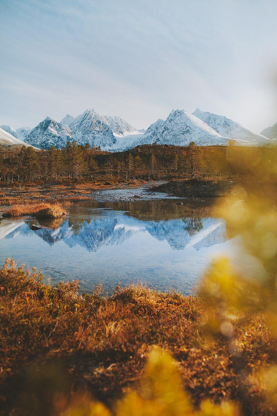 Peaks of Lyngen reflected in a river.