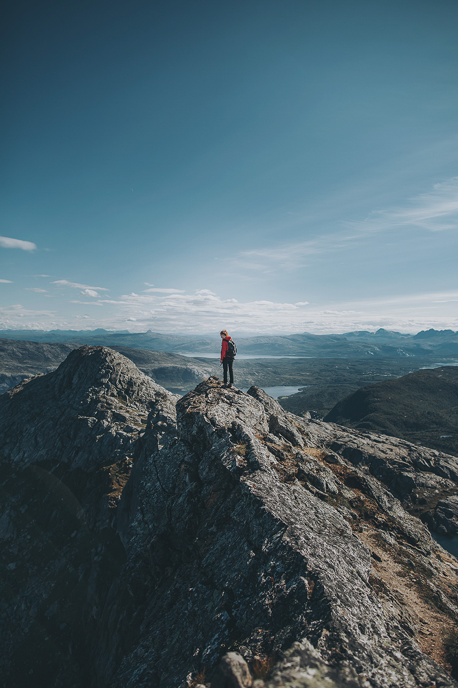 Girl in a red jacket on the top of Steigtind