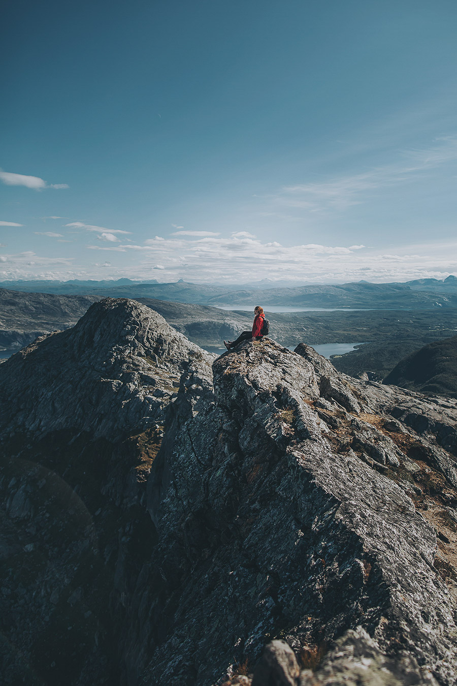 Girl sitting at the top of a mountain