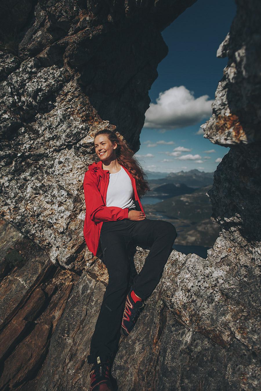 Girl sitting in the mountain window