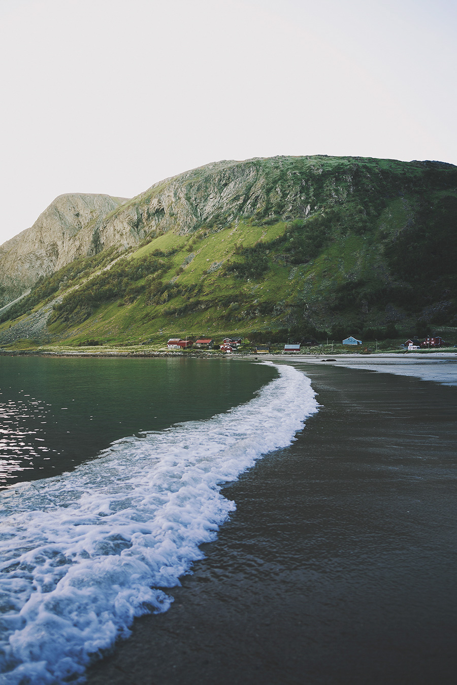 Waves embracing the beach of Grøtfjord