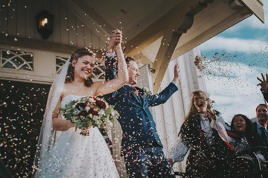 Newlyweds bathing in confetti