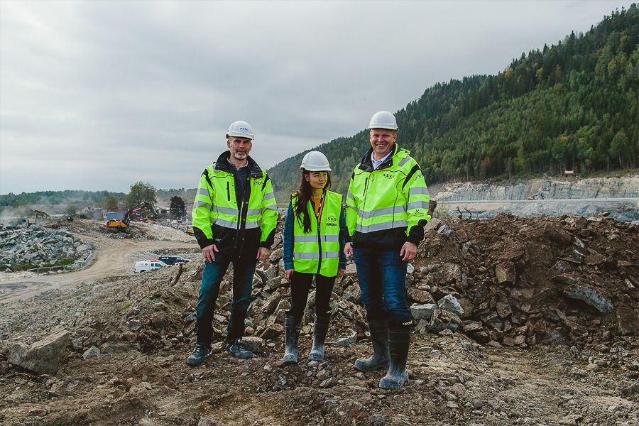 Three people at a construction area