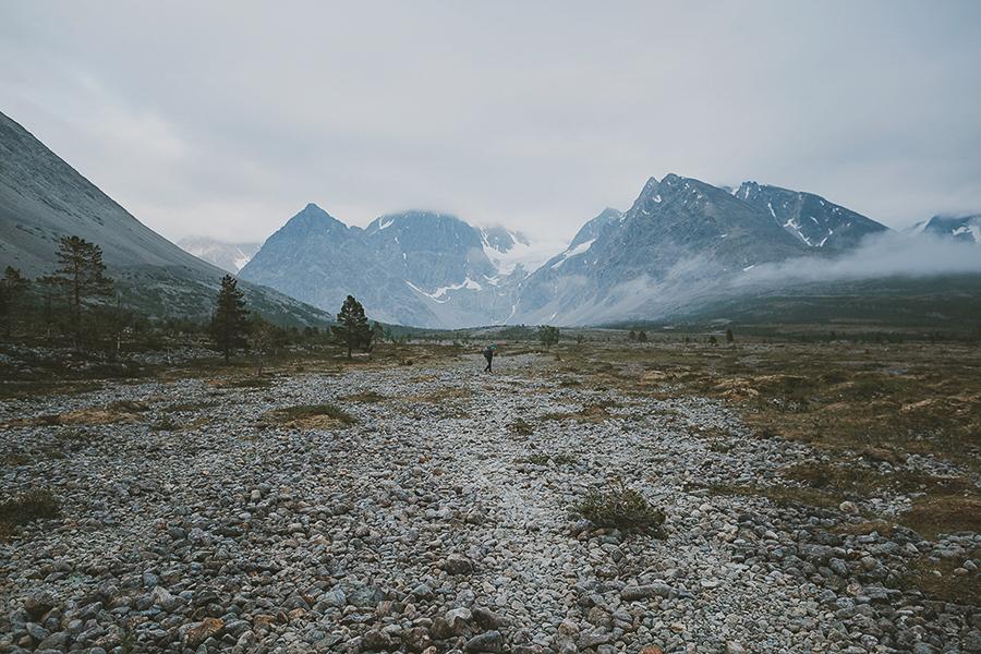 Man hiking towards mountains in Lyngen