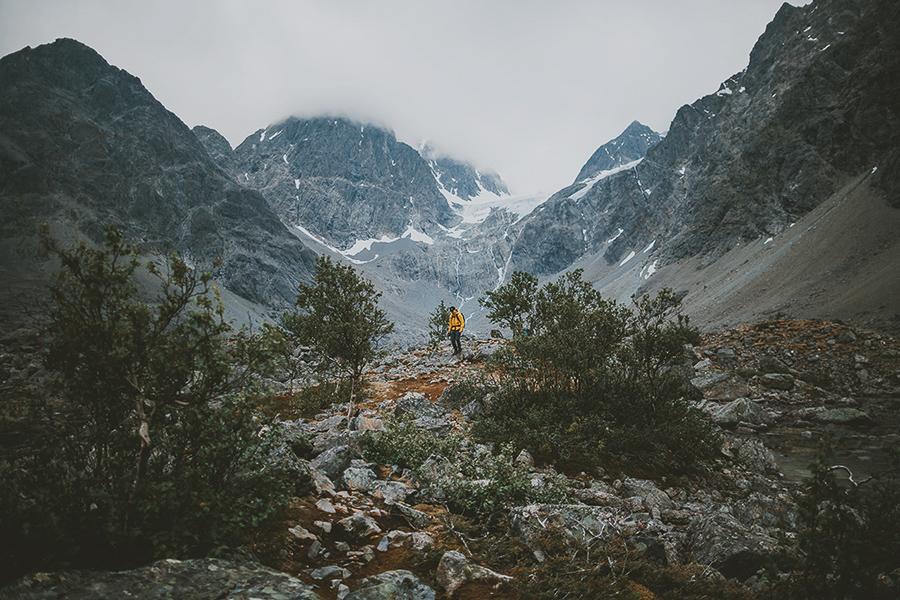 Man in yellow jacket hiking in Lyngen