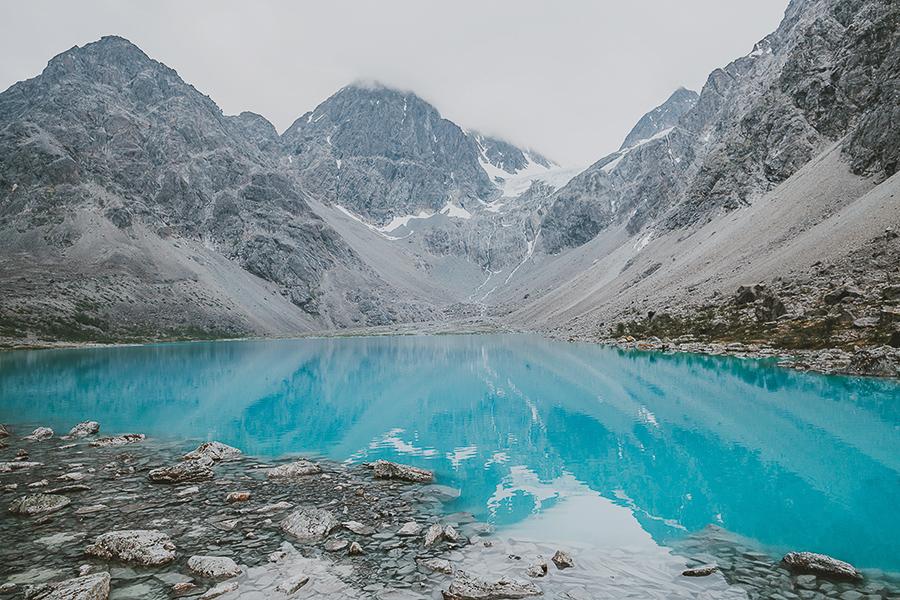 Blåisvatnet reflecting the might Lyngen alps