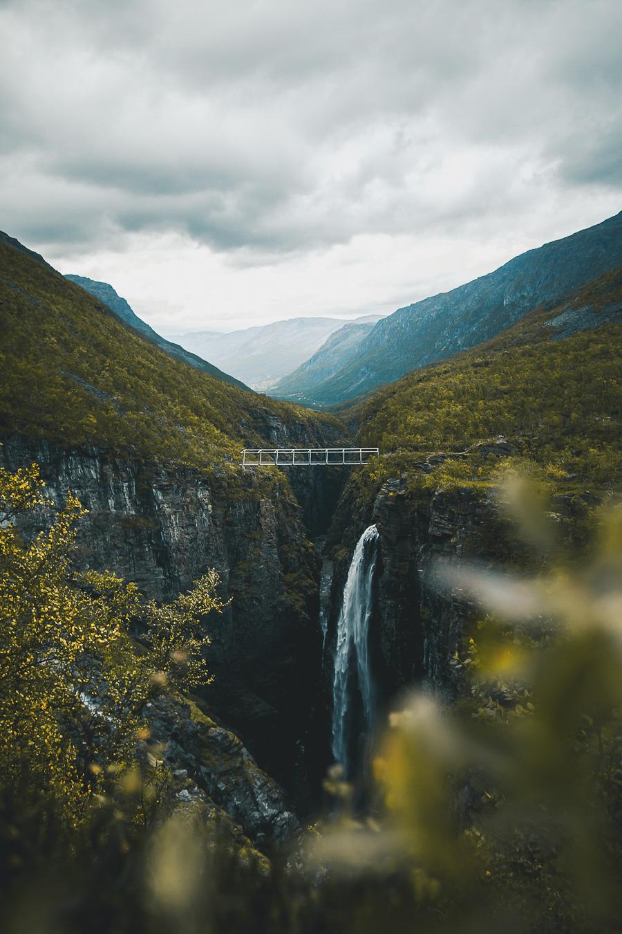 Waterfall dropping 120m under a white bridge