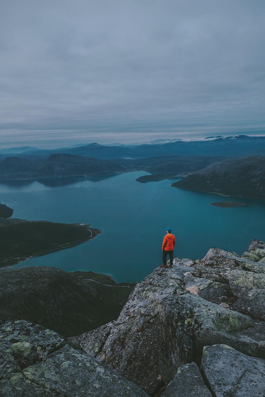 Man in orange jacket looking at Tromsø