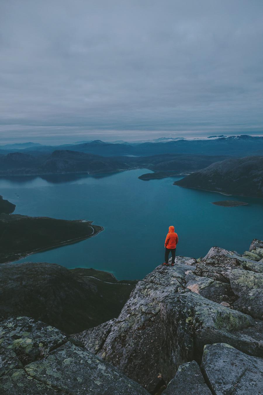Man in orange jacket enjoying the view