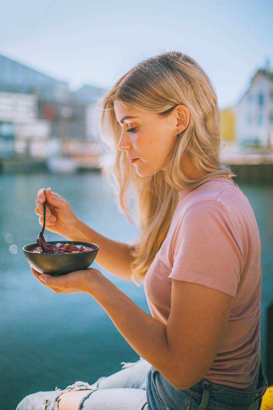 Blonde haired girl eating