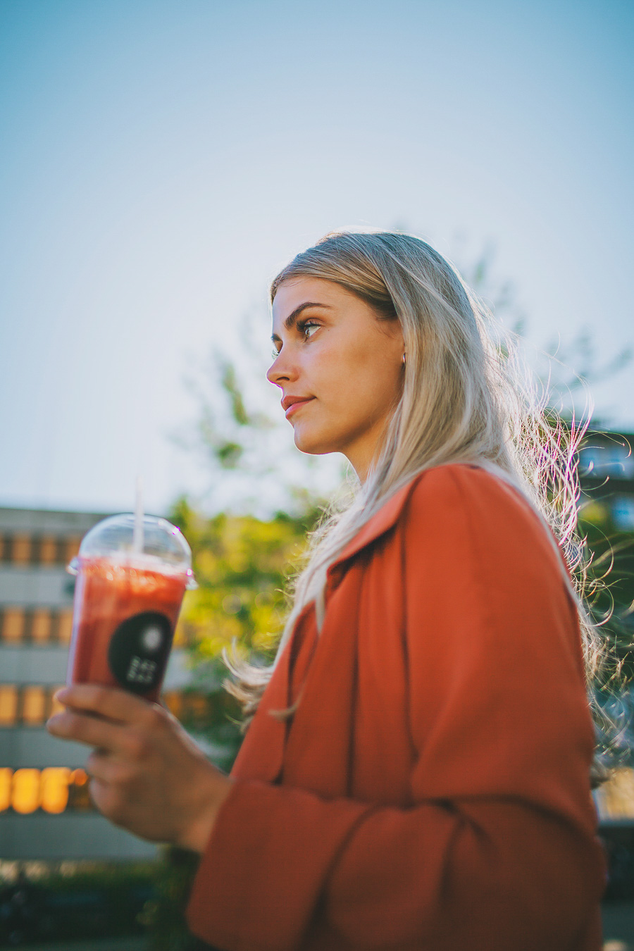 Girl holding a strawberry smoothie