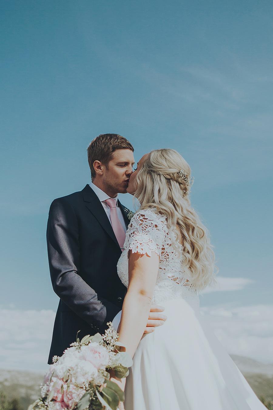 Bridal couple kissing at their wedding