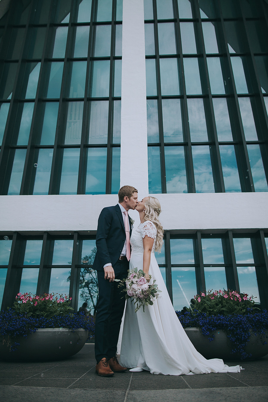 Newlyweds kissing outside of the church