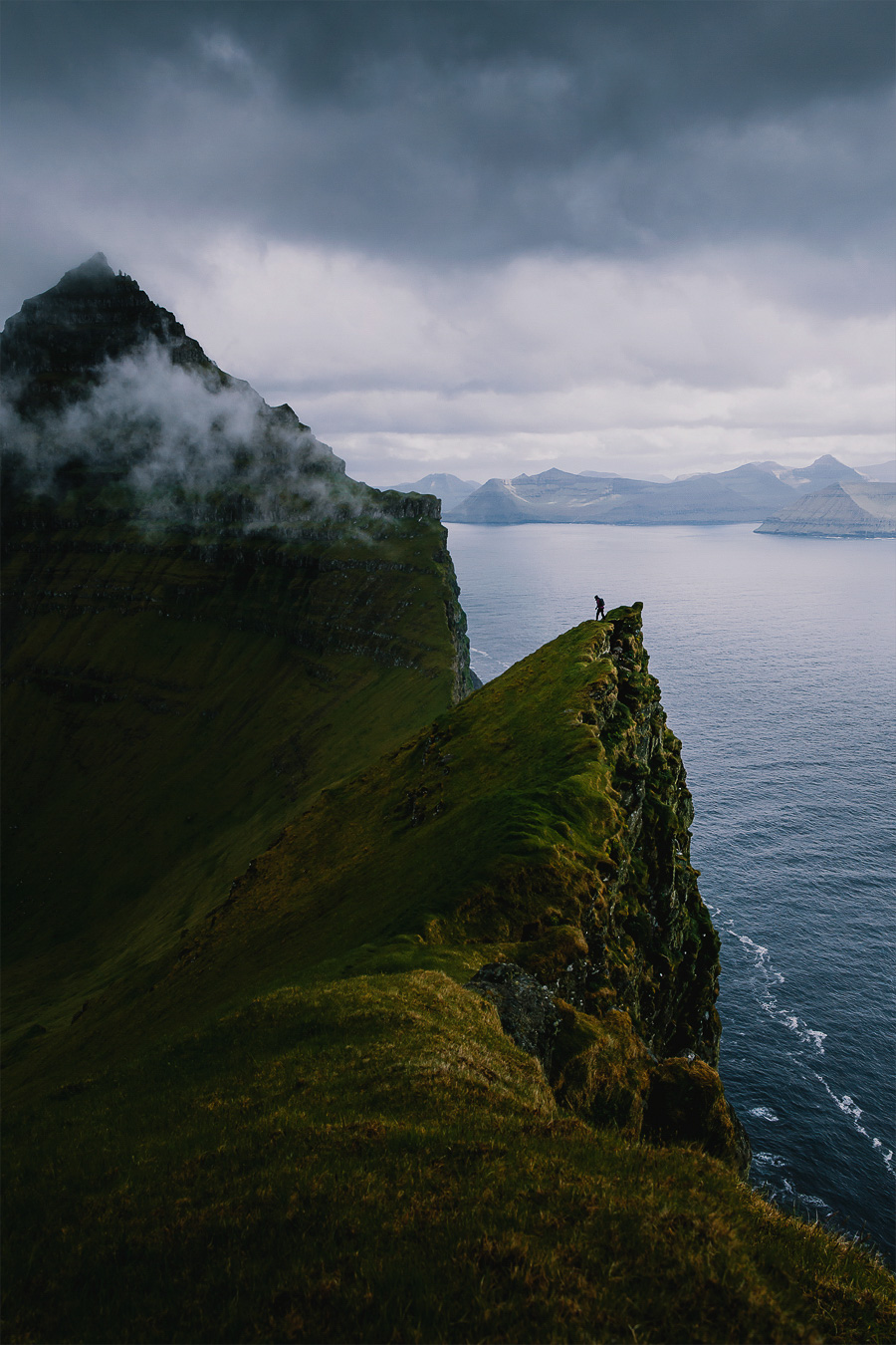 Person hiking the mountains of Faroe Islands