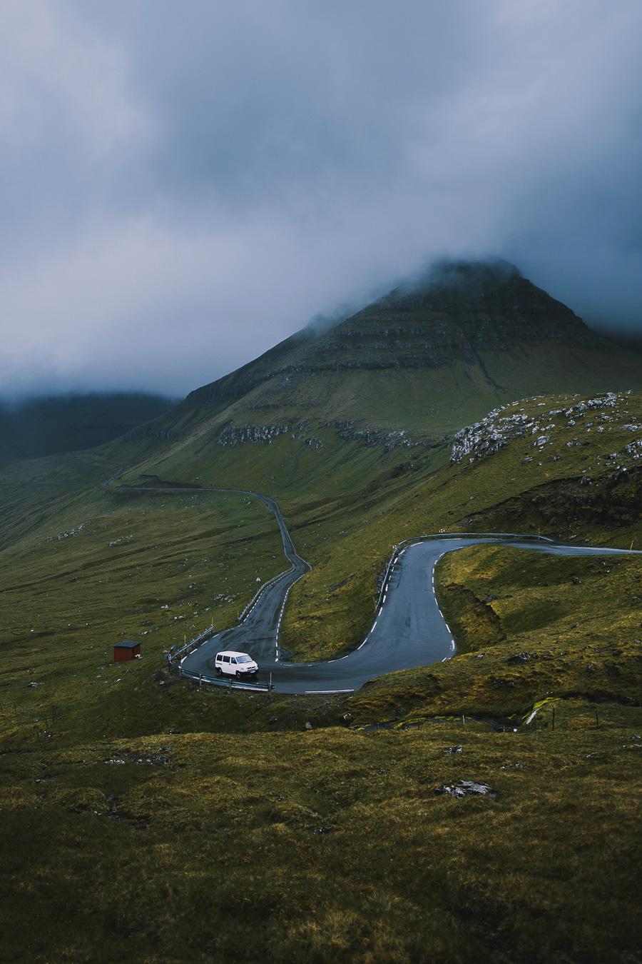 White car driving the windy roads of Faroe Islands