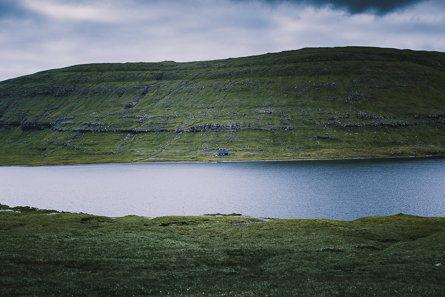 House by the lake in Faroe Islands