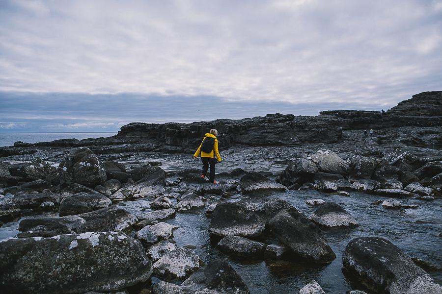 Woman in yellow jacket hiking
