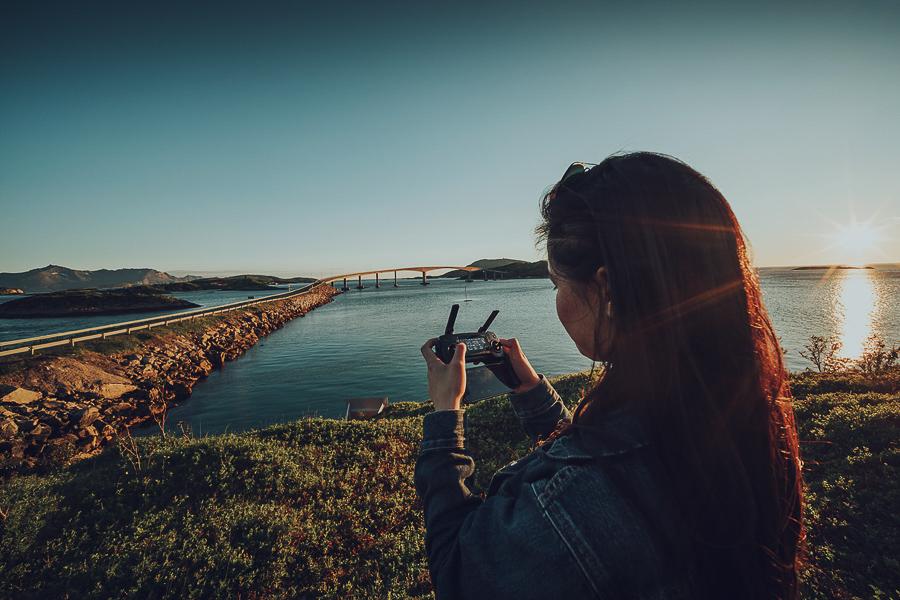 Girl flying a drone in Sommarøy