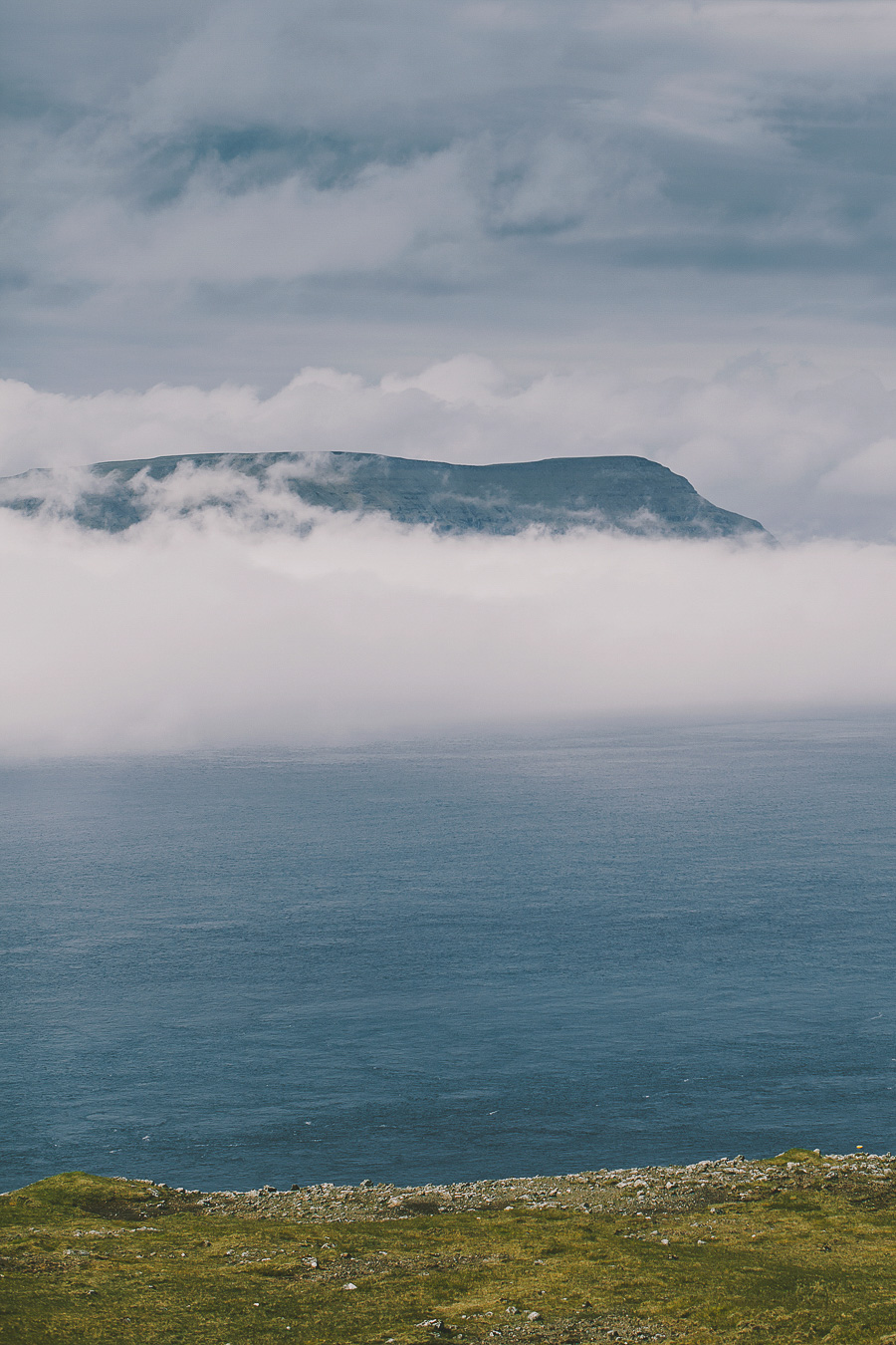 Mountain floating in clouds at Faroe Islands