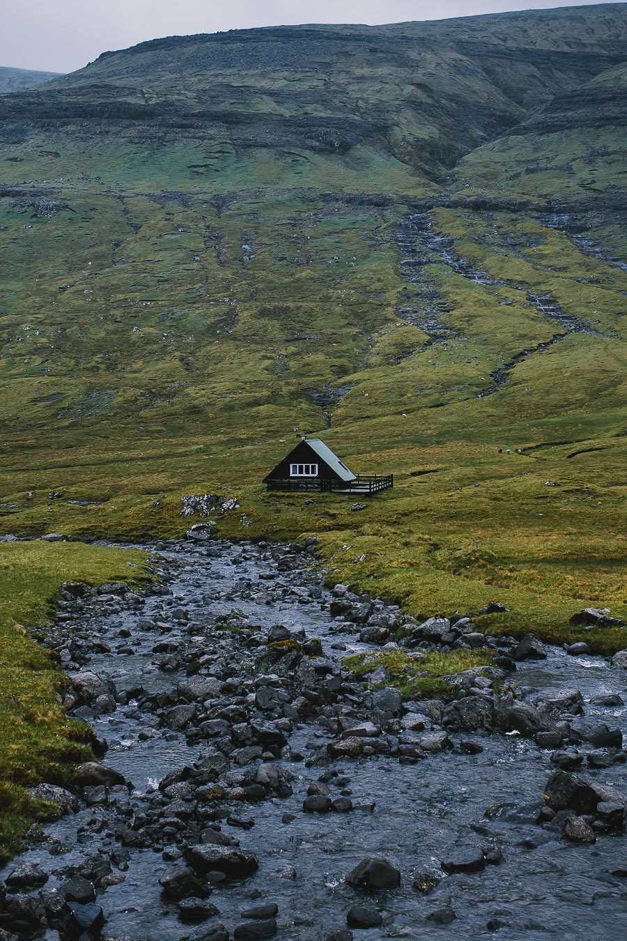 Triangle house by a small river