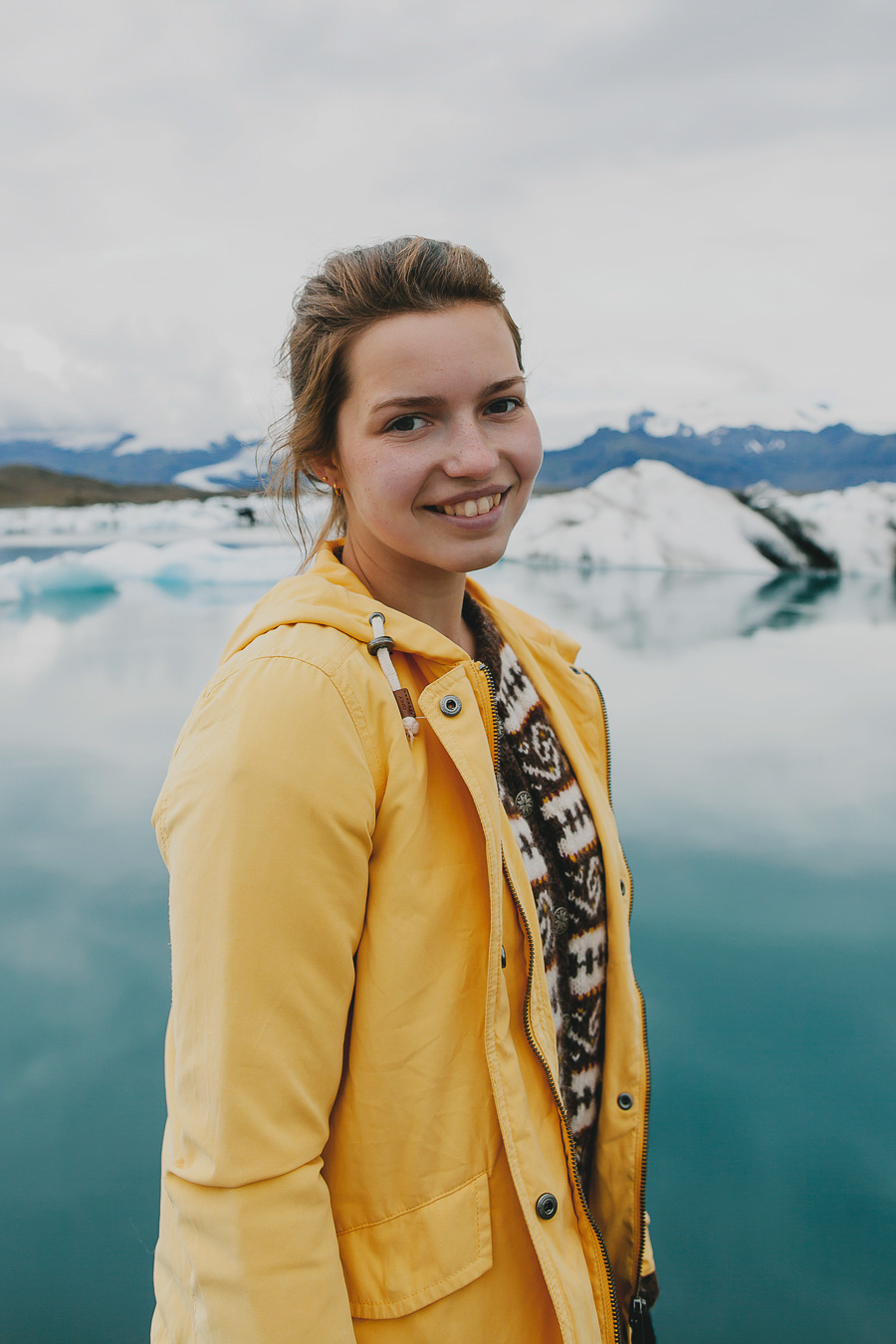 Girl wearing a yellow jacket in Iceland