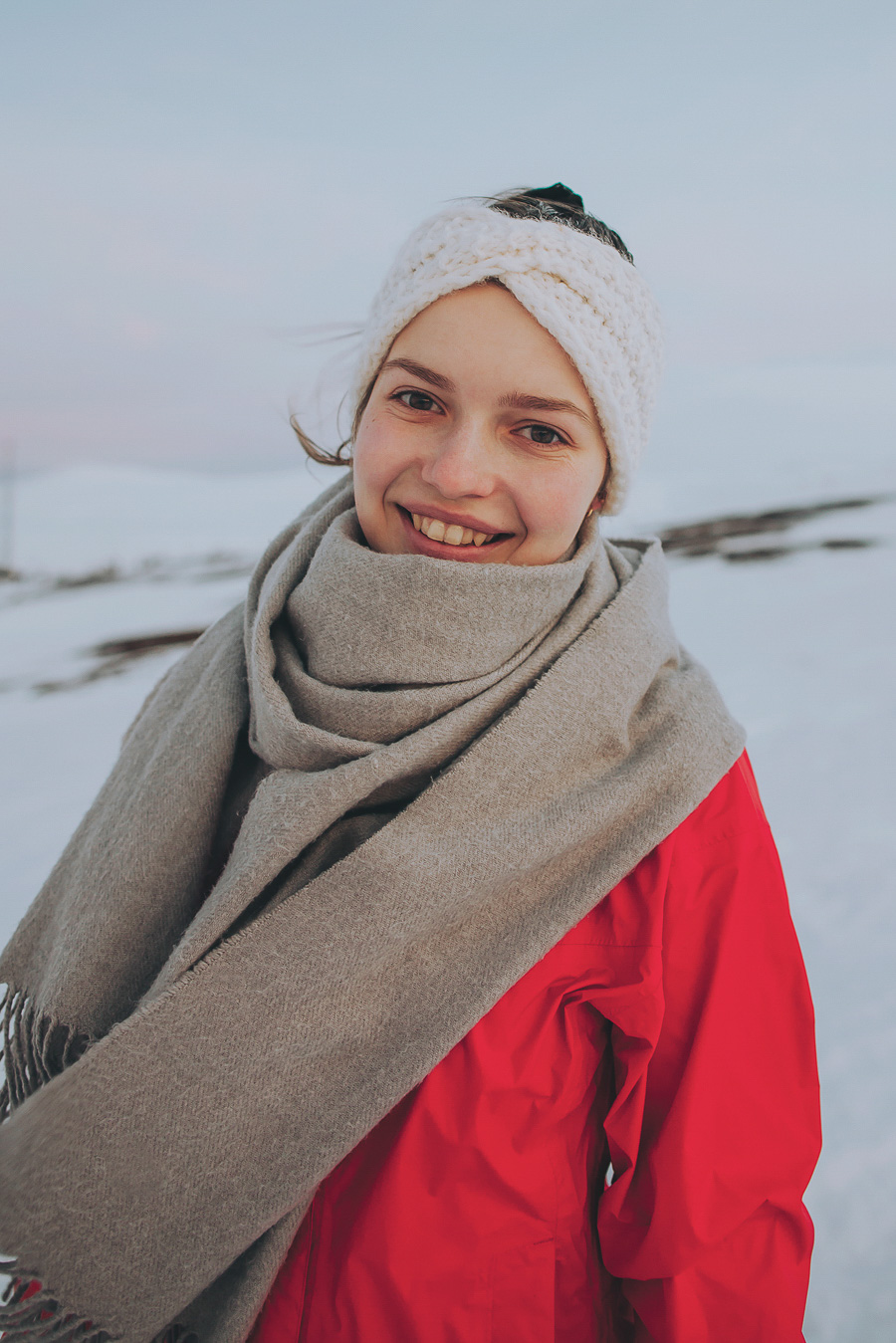 Girl smiling and wearing a red jacket