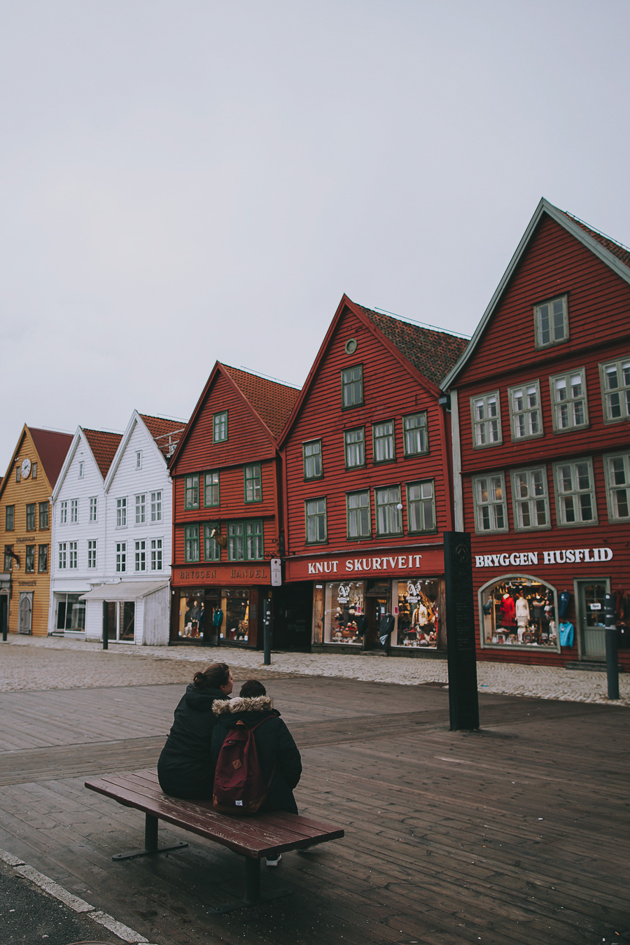 Couple sitting at Bryggen in Bergen