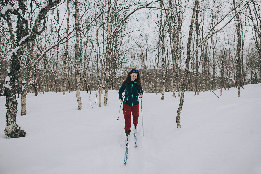 Girl skiing in the woods
