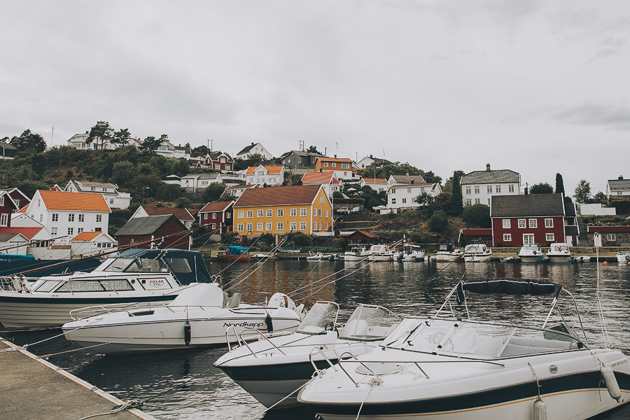Boats and red houses by the ocean
