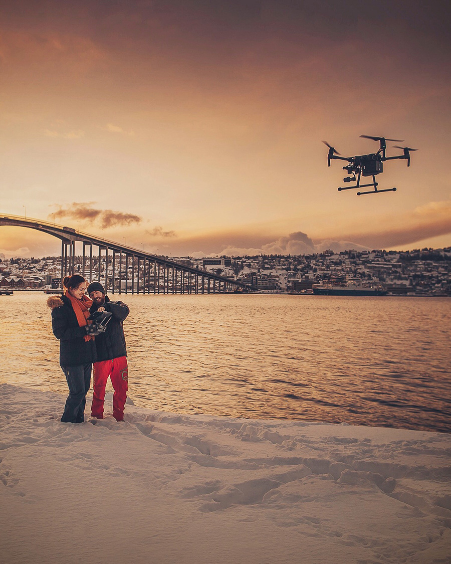 Two students flying a drone in Tromsø