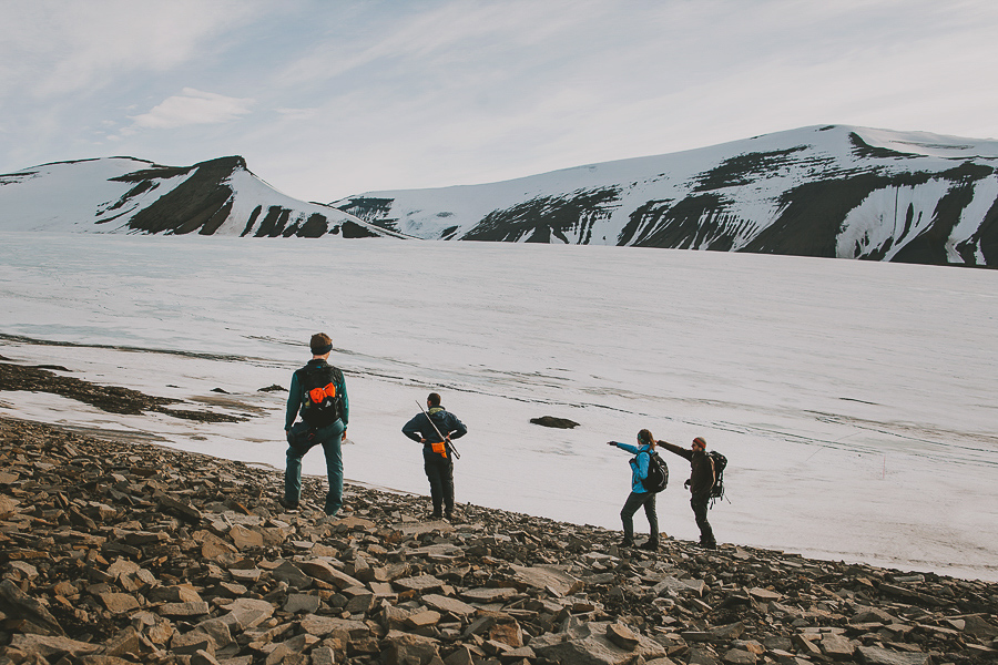 Four people crossing the glacier