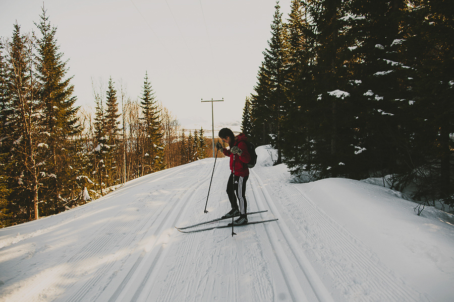 Girl in red jacket skiing