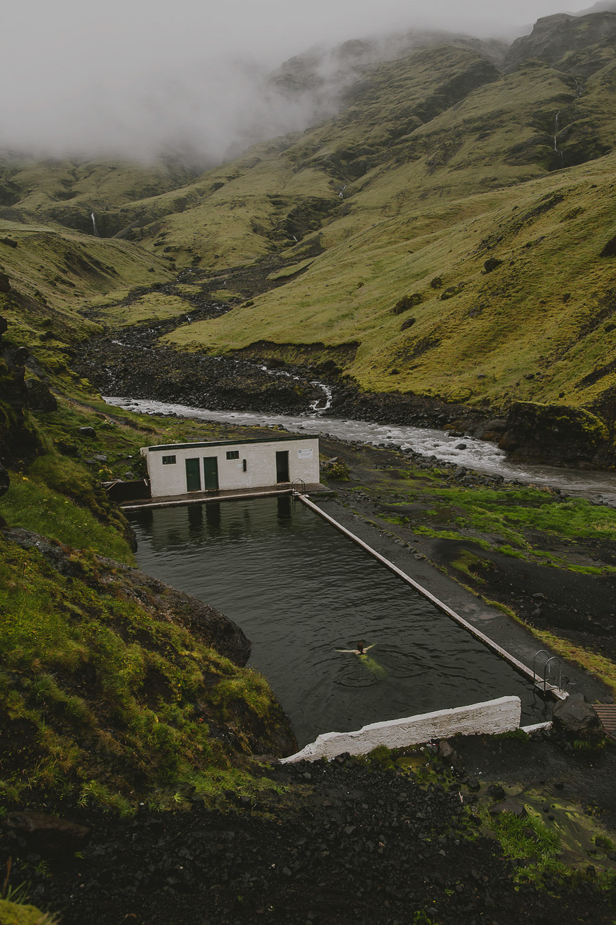 Girl swimming in a natural warm pool in Iceland