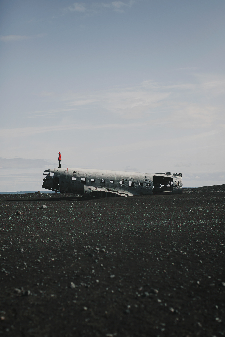 Girl standing on the tip of an airplane