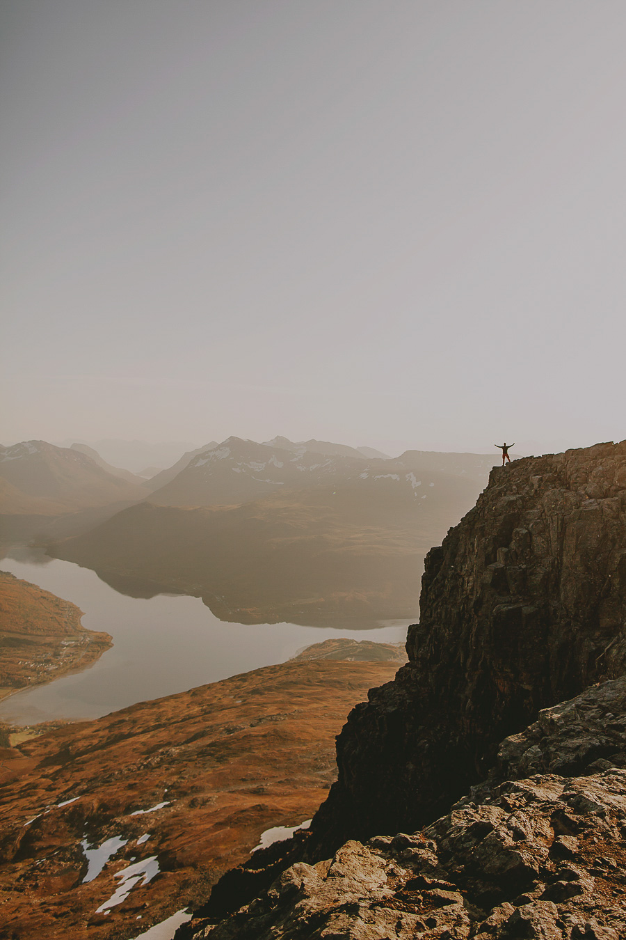Boy standing on the edge of Tromsdalstinden