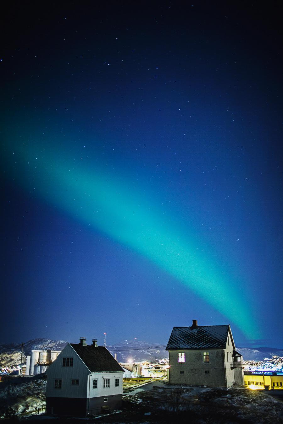Northern lights dancing over Bodø city