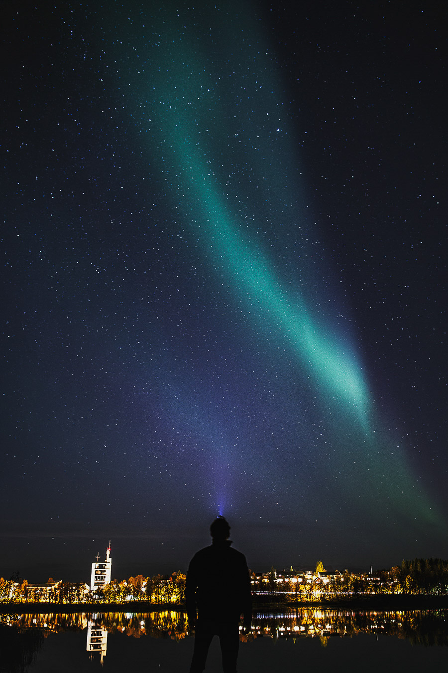 Boy looking up at the northern lights