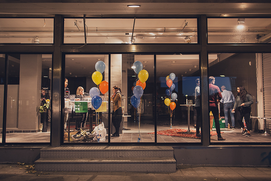 Room with balloons and people