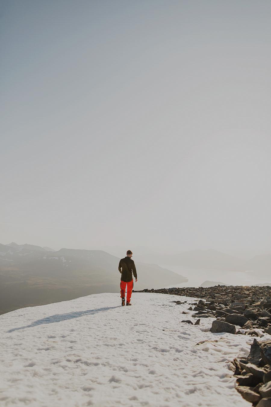 Boy walking on snow