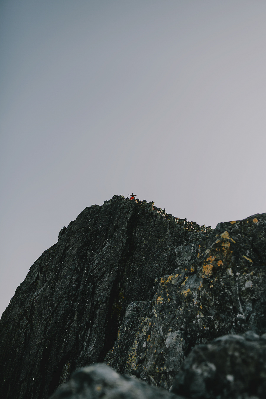 Boy on top of a mountain