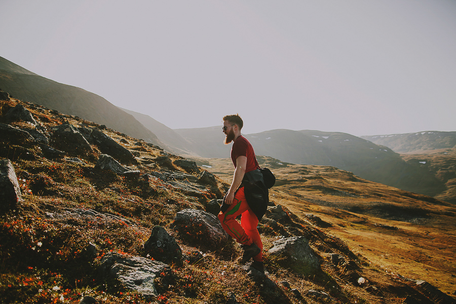 Boy hiking up the mountain