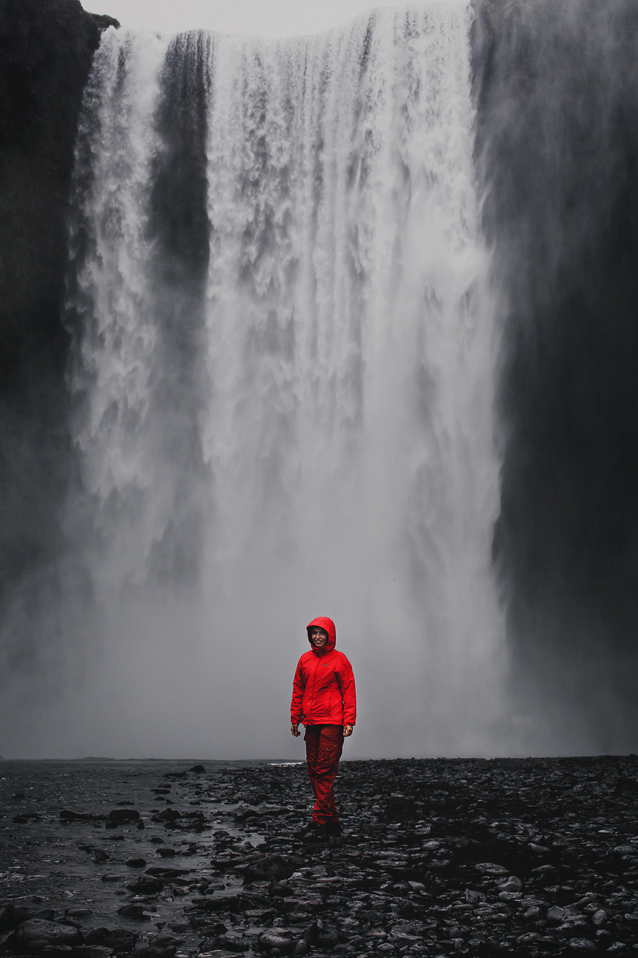 Girl in front of a waterfall