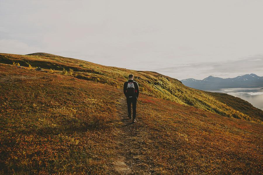 Boy walking in an autumn landscape